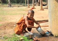Young Monk preparing the food in a Monastery, Siem Reap, Cambodia