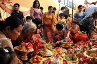 Sorting through the wedding offerings of fruit, Siem Reap, Cambodia