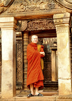 Thai Monk visiting the a temple, Siem Reap, Cambodia