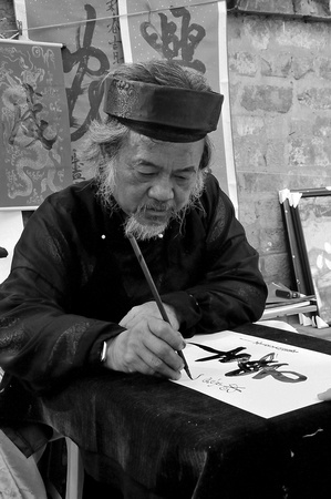 Calligrapher turning out Chinese characters for Tet, Hanoi