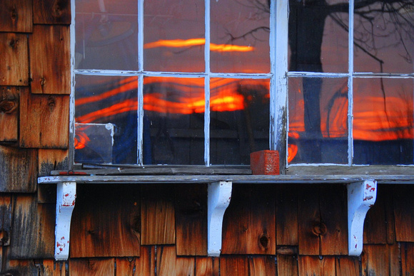 Sunset reflected in a shed window