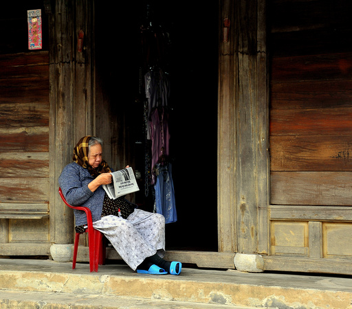 Woman reading the news, Hoi An, Vietnam