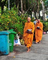 Monks begging in Saigon, Vietnam