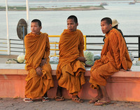 Monks relaxing along the Bassac River, Phnom Penh, Cambodia