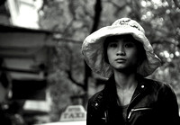 A passerby on the street in Hanoi, Vietnam