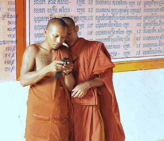Monks check their cell phone